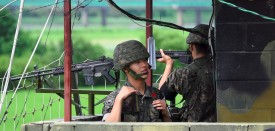 South Korean soldiers stand guard at a guard post near the Demilitarized Zone (DMZ) dividing two Koreas in the border city of Paju on August 11, 2017. As nuclear-armed North Korea's missile stand-off with the US escalates, calls are mounting in the South for Seoul to build nuclear weapons of its own to defend itself -- which would complicate the situation even further. / AFP PHOTO / JUNG Yeon-Je        (Photo credit should read JUNG YEON-JE/AFP/Getty Images)