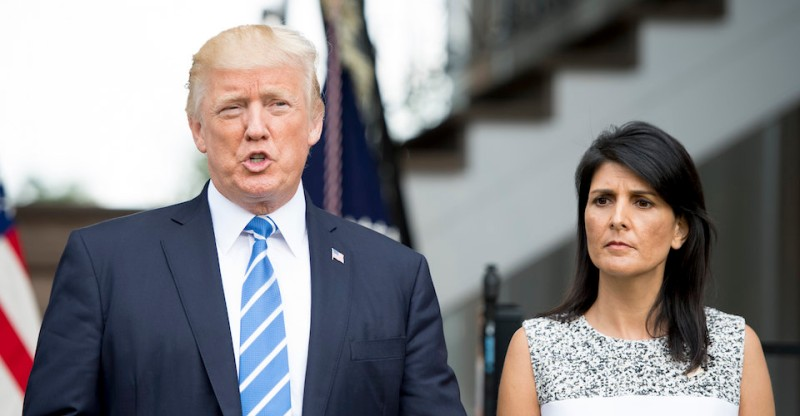 US President Donald Trump (L) speaks to the press with Ambassador to the United Nations Nikki Haley (R) on August 11, 2017, at Trump National Golf Club in Bedminster, New Jersey. Trump said Friday that he was considering options involving the US military as a response to the escalating political crisis in Venezuela.  / AFP PHOTO / JIM WATSON        (Photo credit should read JIM WATSON/AFP/Getty Images)