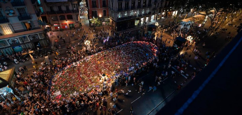 A general view taken on the Rambla boulevard in Barcelona on August 26, 2017 shows people gathering around a flower tibute for the victims of last week's deadly attacks during a march against terrorism which slogan is #NoTincPor (I'm Not Afraid). Tens of thousands of Spaniards and foreigners stagged a defiant march against terror through Barcelona following last week's deadly vehicle rampages. The Mediterranean city is in mourning after a van ploughed into crowds on Las Ramblas boulevard on August 17, followed hours later by a car attack in the seaside town of Cambrils.  / AFP PHOTO / LLUIS GENE        (Photo credit should read LLUIS GENE/AFP/Getty Images)