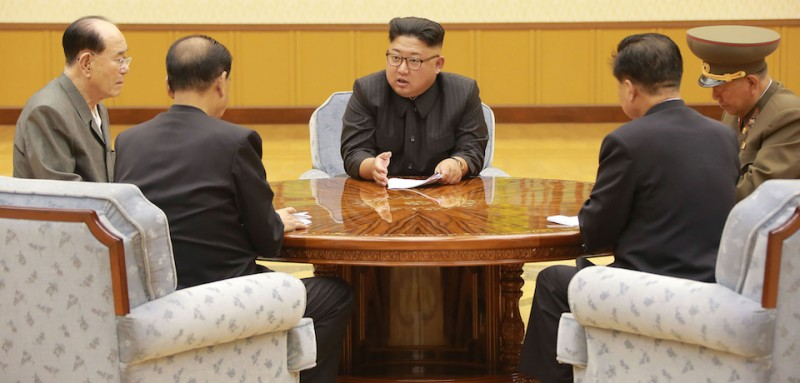 "TOPSHOT - This picture taken on September 3, 2017 and released by North Korea's official Korean Central News Agency (KCNA) on September 4, 2017 shows North Korean leader Kim Jong-Un (C) attending a meeting with a committee of the Workers' Party of Korea about the test of a hydrogen bomb, at an unknown location. North Korea said it detonated a hydrogen bomb designed for a long-range missile on September 3 and called its sixth and most powerful nuclear test a ""perfect success"", sparking world condemnation and promises of tougher US sanctions. / AFP PHOTO / KCNA VIA KNS / STR / South Korea OUT / REPUBLIC OF KOREA OUT   ---EDITORS NOTE--- RESTRICTED TO EDITORIAL USE - MANDATORY CREDIT ""AFP PHOTO/KCNA VIA KNS"" - NO MARKETING NO ADVERTISING CAMPAIGNS - DISTRIBUTED AS A SERVICE TO CLIENTS THIS PICTURE WAS MADE AVAILABLE BY A THIRD PARTY. AFP CAN NOT INDEPENDENTLY VERIFY THE AUTHENTICITY, LOCATION, DATE AND CONTENT OF THIS IMAGE. THIS PHOTO IS DISTRIBUTED EXACTLY AS RECEIVED BY AFP.  /         (Photo credit should read STR/AFP/Getty Images)"