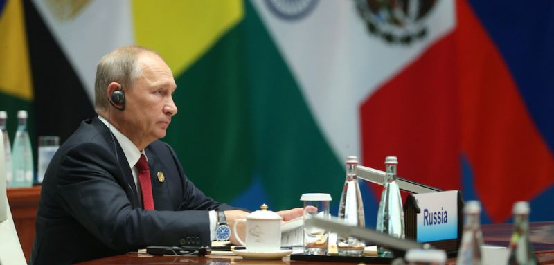 Russian President Vladimir Putin attends the Dialogue of Emerging Market and Developing Countries on the sidelines of the 2017 BRICS Summit in Xiamen, southeastern China's Fujian Province on September 5, 2017. Xi opened the annual summit of BRICS leaders that already has been upstaged by North Korea's latest nuclear weapons provocation. / AFP PHOTO / POOL / WU HONG        (Photo credit should read WU HONG/AFP/Getty Images)