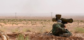 """A member of the Syrian government forces holds a position with an anti-tank missile system in Kobajjep area, on the southwestern outskirts of Deir Ezzor, on September 5, 2017, during the ongoing battle against Islamic State (IS) group jihadists. Syria's army and allied fighters, backed by Russian air support, have been advancing towards Deir Ezzor on several fronts in recent weeks, and entered the Brigade 137 base on its western edge, in what Moscow hailed as a key """"strategic victory"""". / AFP PHOTO / George OURFALIAN        (Photo credit should read GEORGE OURFALIAN/AFP/Getty Images)"""