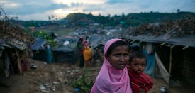 COX'S BAZAR, BANGLADESH - SEPTEMBER 19: Refugees are seen in the Falungkhali Rohingya refugee camp on September 19, 2017 in Cox's Bazar, Bangladesh. Over 400,000 Rohingya refugees have fled into Bangladesh since late August during the outbreak of violence in the Rakhine state as Myanmar's de facto leader Aung San Suu Kyi broke her silence on the Rohingya crisis on Tuesday and defended the security forces while criticism on her handling of the Rohingya crisis grows. Recent satellite images released by Amnesty International provided evidence that security forces were trying to push the minority Muslim group out of the country. (Photo by Allison Joyce/Getty Images)
