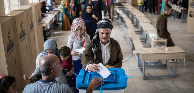 KIRKUK, IRAQ - SEPTEMBER 25: People are seen casting their referendum vote at a voting station on September 25, 2017 in Kirkuk, Iraq. Despite strong objection from neighboring countries and the Iraqi government. Some five million Kurds took to the polls today across three provinces in the historic independence referendum.  (Photo by Chris McGrath/Getty Images)