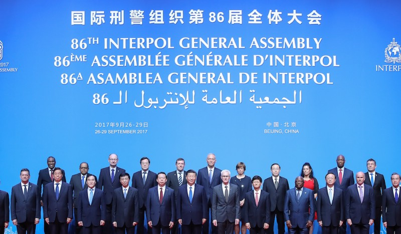 BEIJING, CHINA - SEPTEMBER 26:  Chinese President Xi Jinping (C) with Secretary General Interpol Jurgen Stock (Center-R) and Meng Hongwei (Center-L), president of Interpol pose for a group photo before the 86th INTERPOL General Assembly at Beijing National Convention Center on September 26, 2017 in Beijing, China. The General Assembly, themed 'Connecting Police for a Safer World',  will take place in Beijing from September 26-29. (Photo by Lintao Zhang - Pool/Getty Images)