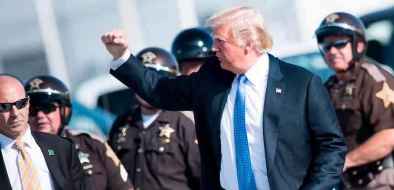 US President Donald Trump walks from motorcycle police to Air Force One at Indianapolis International Airport on September 27, 2017, in Indianapolis, Indiana. / AFP PHOTO / Brendan Smialowski        (Photo credit should read BRENDAN SMIALOWSKI/AFP/Getty Images)