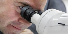 Russian President Dmitry Medvedev looks through a microscope during a visit to the Kurchatov scientific research institute in Moscow on September 30, 2009. Medvedev made a working visit to the research center.                 AFP PHOTO / POOL / MAXIM SHIPENKOV (Photo credit should read MAXIM SHIPENKOV/AFP/Getty Images)