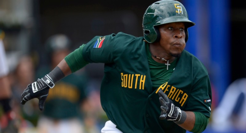 SYDNEY, AUSTRALIA - FEBRUARY 14: Gift Ngoepe of South Africa runs to first base during the World baseball Classic Final match between Australia and South Africa at Blacktown International Sportspark on February 14, 2016 in Sydney, Australia.  (Photo by Brett Hemmings/Getty Images)