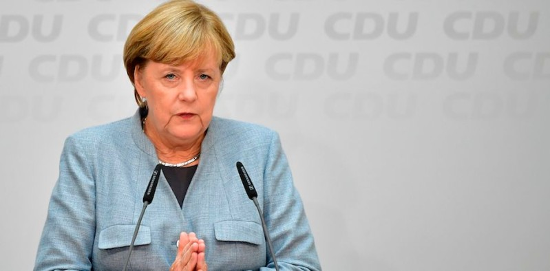 German Chancellor Angela Merkel attends a press conference at the headquarters of the Christian Democratic Union (CDU) party in Berlin on September 25, 2017, one day after general elections. Merkel woke up to a fourth term but now faces the double headache of an emboldened hard-right opposition party and thorny coalition talks ahead. / AFP PHOTO / Tobias SCHWARZ / ALTERNATIVE CROP         (Photo credit should read TOBIAS SCHWARZ/AFP/Getty Images)