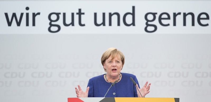 German Chancellor Angela Merkel delivers her speech as she attends an electoral meeting in Delbrueck, western Germany, on September 10, 2017. / AFP PHOTO / dpa / Friso Gentsch / Germany OUT        (Photo credit should read FRISO GENTSCH/AFP/Getty Images)