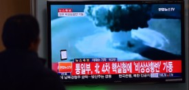 "TOPSHOT - ADDITION- People watch a news report on North Korea's first hydrogen bomb test at a railroad station in Seoul on January 6, 2016. South Korea ""strongly"" condemned North Korea's shock hydrogen bomb test and vowed to take ""all necessary measures"" to penalise its nuclear-armed neighbour.  The image shown on TV shows files images from other nuclear tests from other countries and the caption in red at the bottom of the screen reads ""the Blue House will convene an emergency meeting of the NSC, the National Security Council.""   AFP PHOTO / JUNG YEON-JE / AFP / JUNG YEON-JE        (Photo credit should read JUNG YEON-JE/AFP/Getty Images)"