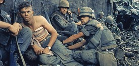 """VIETNAM WAR- 25TH ANNIVERSARY:  D.R. Howe treats the wounds of Private First Class D.A. Crum, """"H"""" Company, 2nd Battalion, Fifth Marine Regiment, During Operation Hue City in Vietnam 06 February, 1968 AFP PHOTO/NATIONAL ARCHIVES (Photo credit should read NATIONAL ARCHIVES/AFP/Getty Images)"""