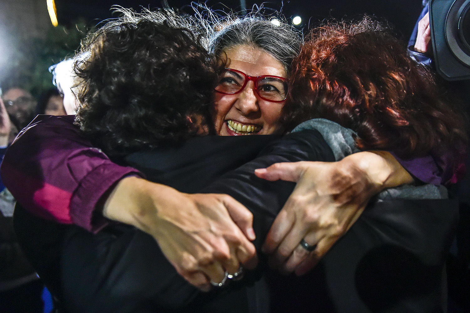 TOPSHOT - Ozlem Dalkiran (C), member of Citizens' Assembly is seen after her release from Silivri prison in Istanbul on October 26, 2017. Eight human rights activists, including Amnesty International's Turkey director Idil Eser, were greeted by celebrating relatives and supporters as they were released from jail near Istanbul early on October 26. / AFP PHOTO / YASIN AKGUL        (Photo credit should read YASIN AKGUL/AFP/Getty Images)