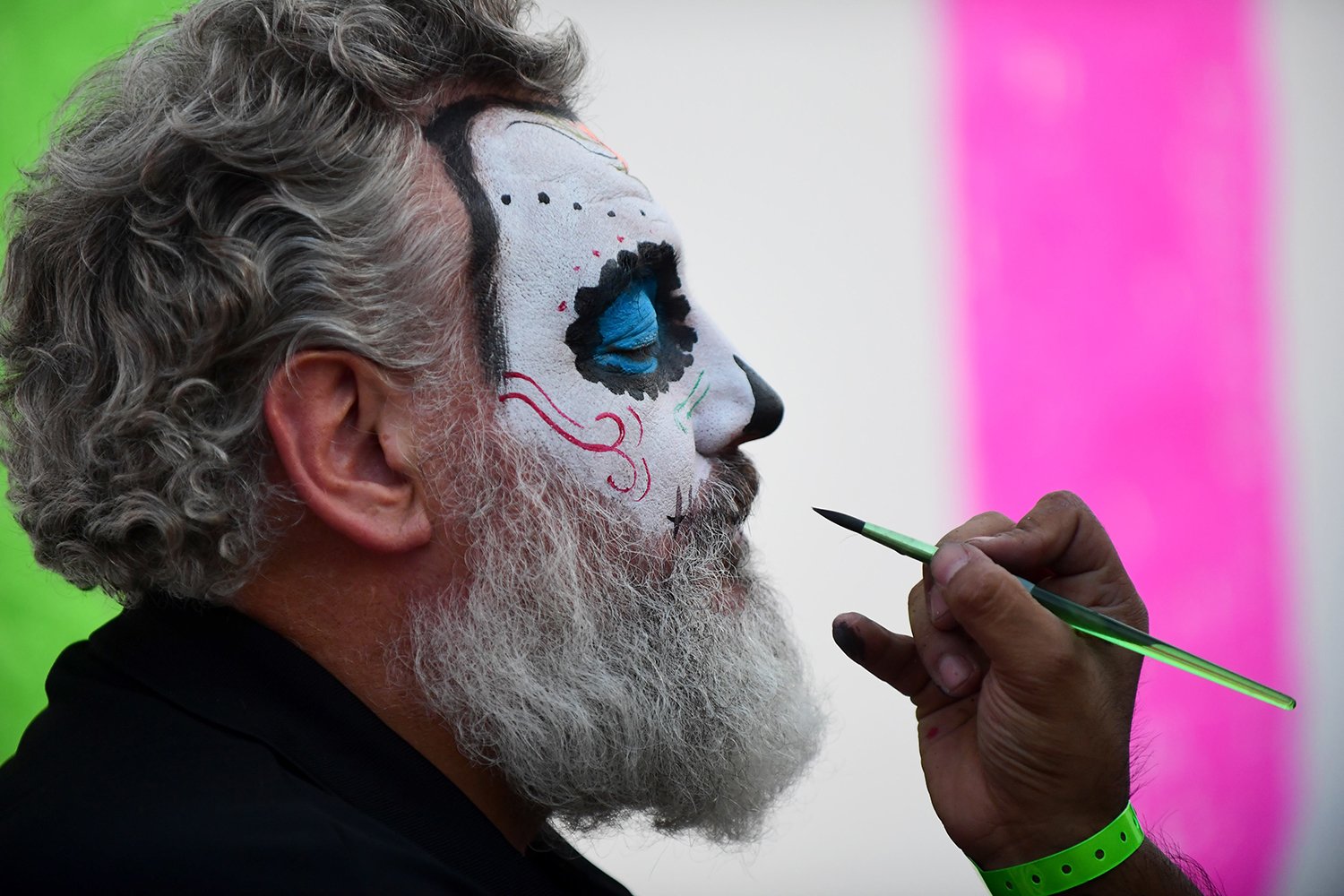 TOPSHOT - A man has his face painted during celebrations in the framework of the Day of the Dead at the Hermanos Rodriguez racetrack in Mexico City, on October 26, 2017 ahead of the week-end's Mexican Formula One Grand Prix. / AFP PHOTO / Pedro PARDO        (Photo credit should read PEDRO PARDO/AFP/Getty Images)