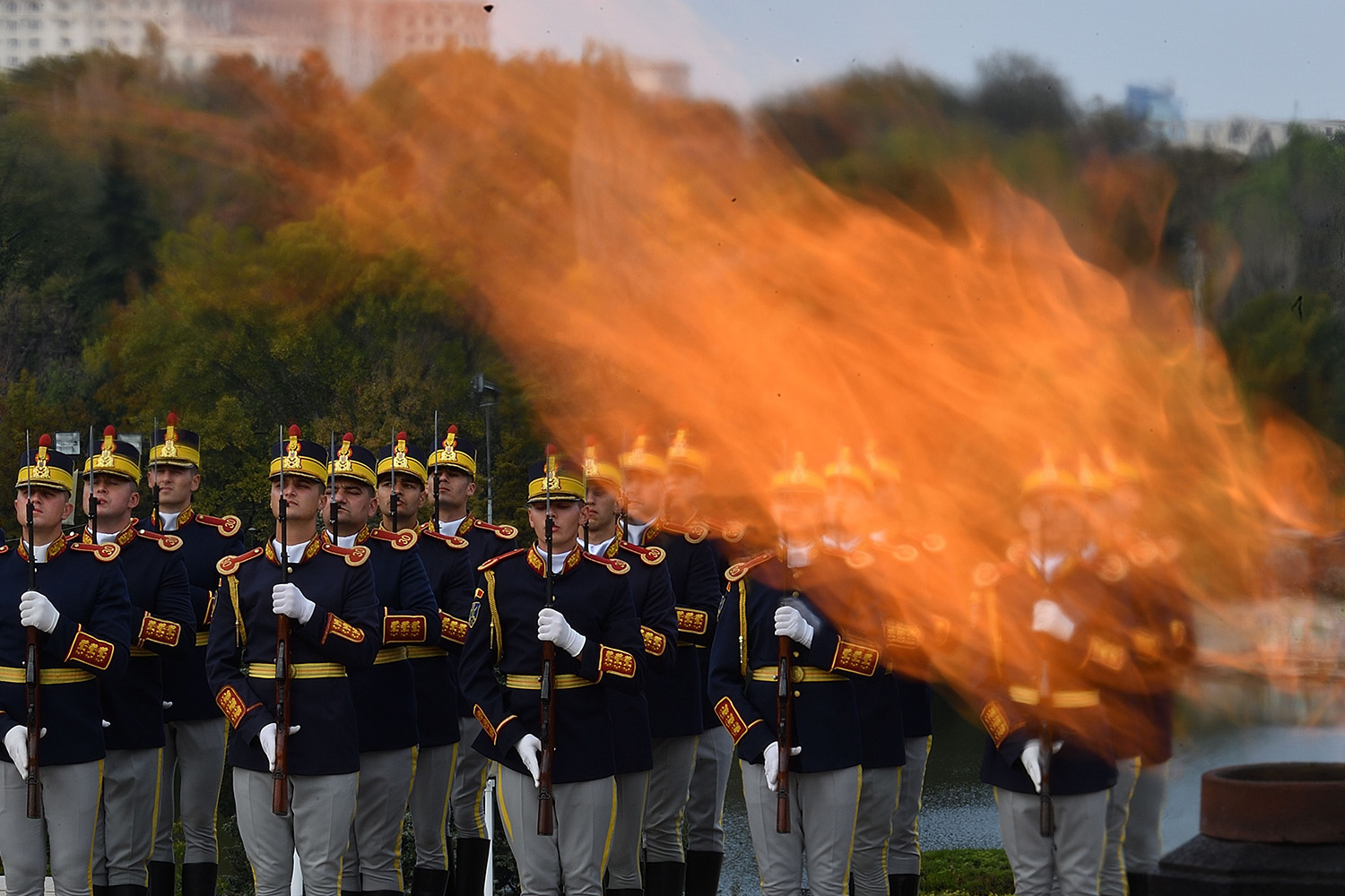 TOPSHOT - Romanian military takes part in celebration of the Romanian Army Force's Day next to the Monument of Unknown Soldier at Carol Park in Bucharest October 25, 2017. The Day of the Romanian Army is the day when Romania celebrates the Army, which on October 25, 1944, liberated the last territory of the country from horthyst occupation, in the central Transylvania region.  / AFP PHOTO / Daniel MIHAILESCU AND DANIEL MIHAILESCU        (Photo credit should read DANIEL MIHAILESCU/AFP/Getty Images)