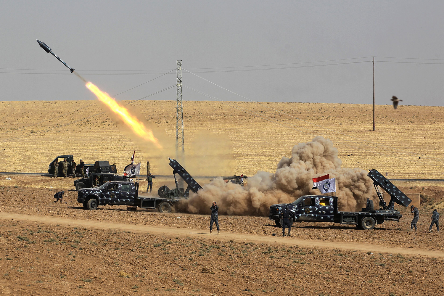 TOPSHOT - A picture taken on October 26, 2017 shows rockets being launched from Iraqi security forces' against Kurdish Peshmerga positions in the area of Faysh Khabur, which is located on the Turkish and Syrian borders in the Iraqi Kurdish autonomous region. / AFP PHOTO / AHMAD AL-RUBAYE        (Photo credit should read AHMAD AL-RUBAYE/AFP/Getty Images)