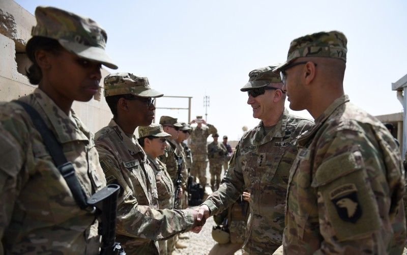 The US commander in Afghanistan John Nicholson shakes hands with US soldiers. WAKIL KOHSAR/AFP/Getty Images