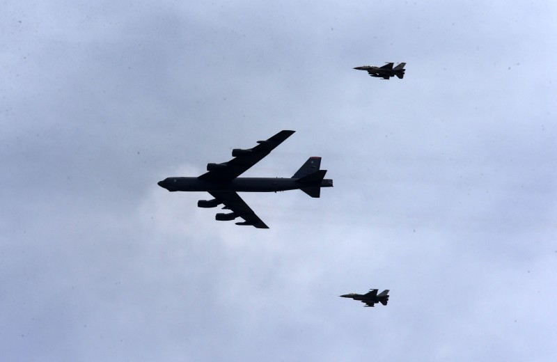 A B-52 Stratofortress and F-16 jets in flight in October, 2015. (Jordan Pix/ Getty Images)