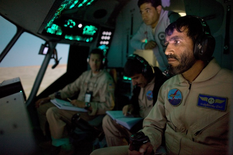 Afghan army trainees inside a helicopter simulator at a military base in Kabul, Afghanistan, on Oct. 21, 2009. (Paula Bronstein/Getty Images)