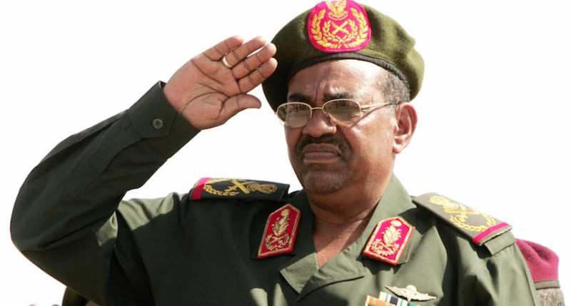 Sudanese President and Commander in Chief Omar al-Bashir salutes during a ceremony to mark the 53rd anniversary of the creation of the Sudanese armed forces in the northern Sudanese city of Merowe, on August 14, 2007. Isam Al-Haj/AFP/Getty Images)