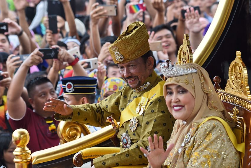 Brunei's Sultan Hassanal Bolkiah and Queen Saleha ride in a royal chariot during a procession to mark his golden jubilee of accession to the throne in Bandar Seri Begawan on October 5, 2017. ROSLAN RAHMAN/AFP/Getty Images)