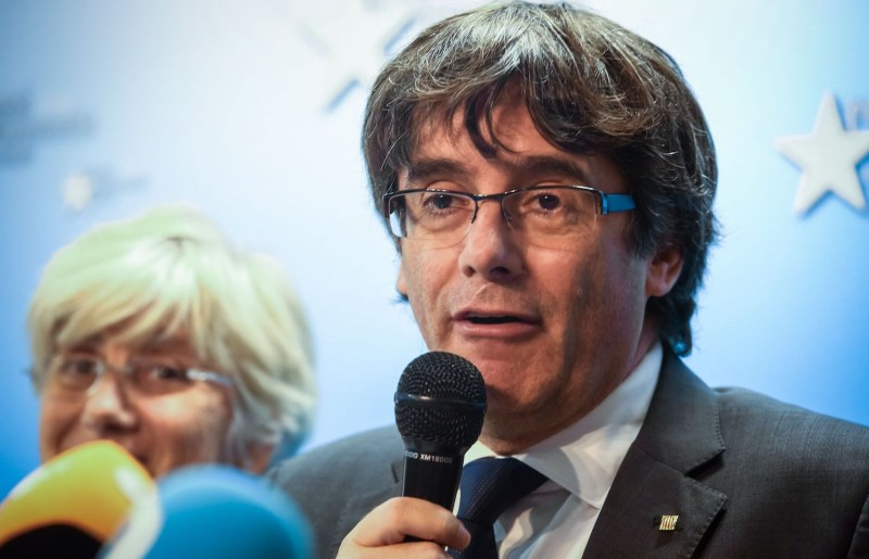 Catalonia's dismissed leader Carles Puigdemont (right), along with other members of his dismissed government address a press conference at The Press Club in Brussels on Oct. 31, 2017. (Aurore Belot/AFP/Getty Images)