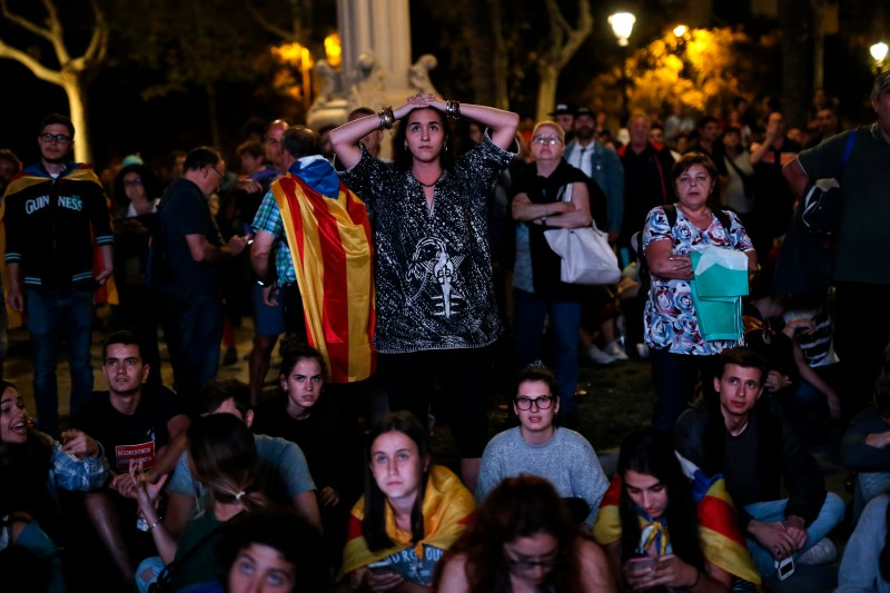 Supporters of an independence for Catalonia listen to Catalan president Carles Puigdemont's speech  in Barcelona on October 10, 2017. ( Pau Barrena/AFP/Getty Images)