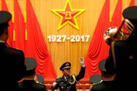 A military band conductor rehearses ahead a ceremony to commemorate the 90th anniversary of the founding of the People's Liberation Army, at the Great Hall of the People in Beijing on Aug. 1. (Andy Wong/AFP/Getty Images)