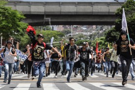 Students protest in Medellin, Colombia, on Oct. 12 during a protest in the framework of a general strike. (Joaquin Sarmiento/AFP/Getty Images)