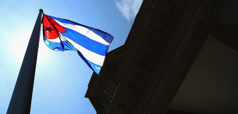 The Cuban flag flies by the country's Washington, D.C. embassy in July 2015. / Chip Somodevilla / Getty Images