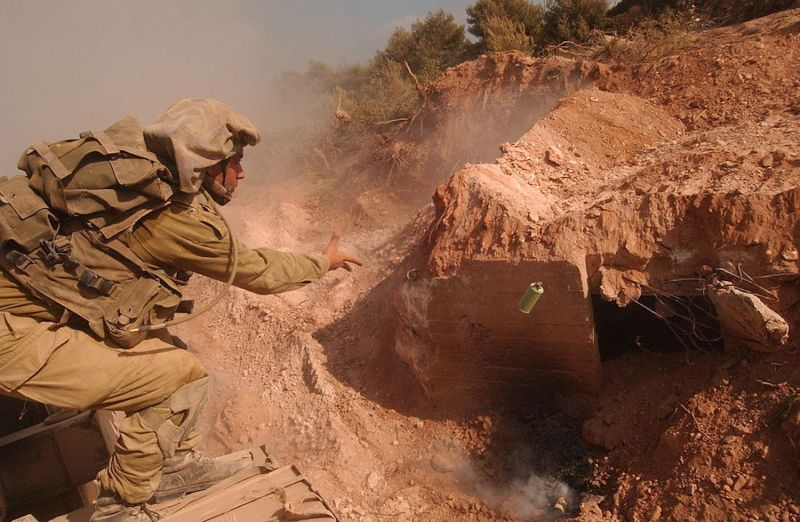 An Israeli soldier throws a grenade into a Hezbollah bunker during the 2006 Lebanon war. (Wikimedia Commons)