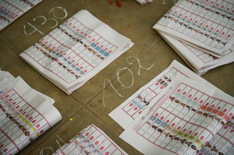 Marked ballot papers sit in piles at the Twalemishe school polling station in Kamalondo district of Lubumbashi on November 29, 2011.   Monitors reported widespread fraud in Democratic Republic of Congo elections and presidential rivals demanded an annulment as votes were counted Tuesday in polling marred by deadly violence. AFP PHOTO / PHIL MOORE (Photo credit should read PHIL MOORE/AFP/Getty Images)