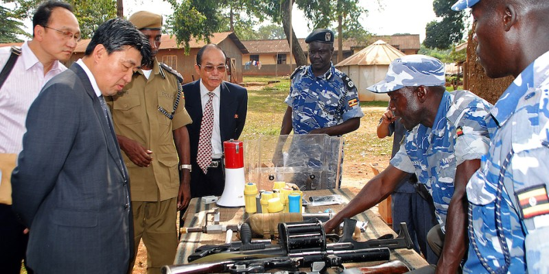 The vice minister of the North Korean Ministry of People's Security inspects weapons at a police training academy in Kampala, Uganda, on June 13, 2013.