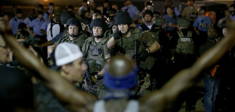 Police and demonstrators during protests in Ferguson, Missouri in 2014 (Joe Raedle/Getty Images).
