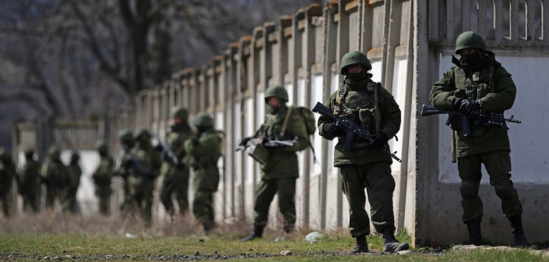 Russian military personnel surround a Ukrainian army base in 2014. (Dan Kitwood/Getty Images)