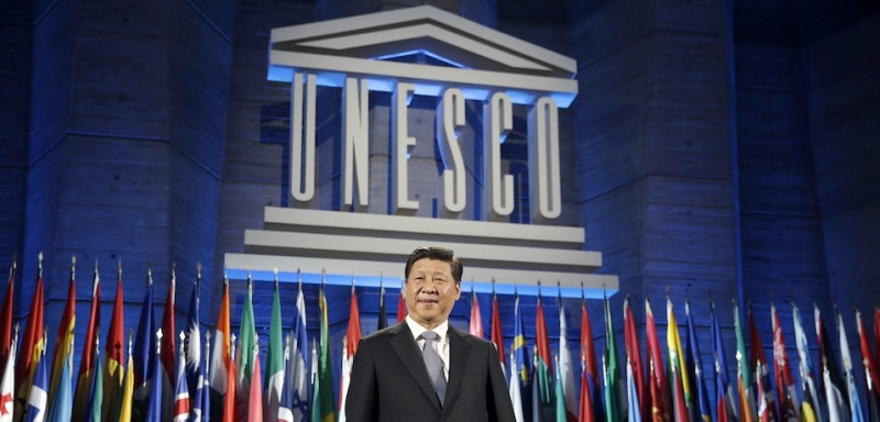 China's President Xi Jinping poses after delivering his speech at the UNESCO headquarters in Paris on March 27, 2014. After a day devoted to multi-billion-dollar business deals, Chinese leader Xi Jinping trained his sights on culture and history today on the last day of his lavish visit to France. AFP PHOTO / POOL / Christian Hartmann        (Photo credit should read CHRISTIAN HARTMANN/AFP/Getty Images)