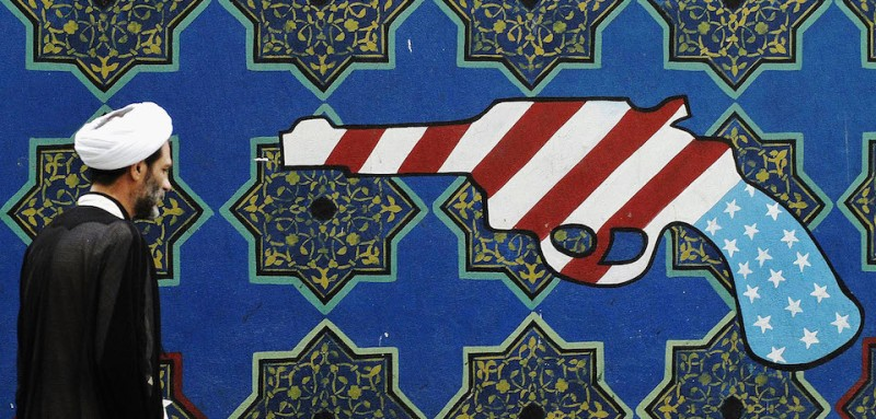 An image of an American flag stylized as a gun in Tehran, Iran.