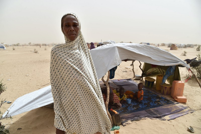 A displaced woman fleeing from the Boko Haram attacks in Bosso stands in the front of her makeshift tent in a camp in the village of Kidjendi near Diffa, Niger, on June 19, 2016 (ISSOUF SANOGO/AFP/Getty Images)