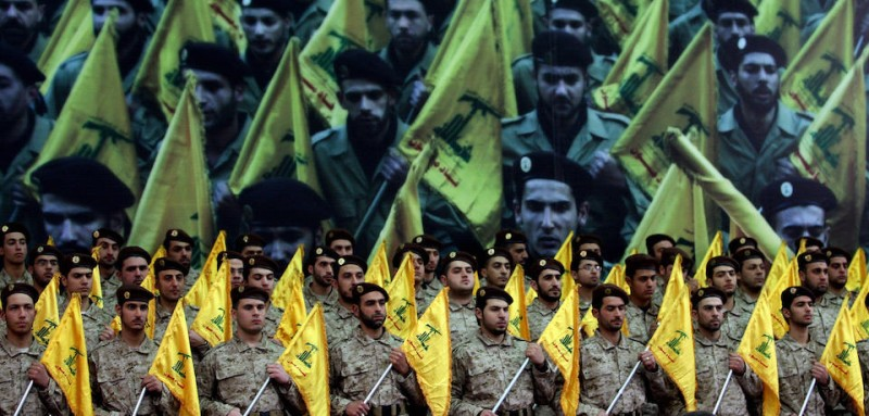 Hezbollah fighters gather to watch a televised speech by leader Hassan Nasrallah in 2008 (JOSEPH BARRAK/AFP/Getty Images).