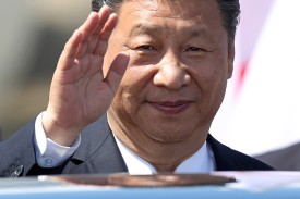 Chinese President Xi Jinping waves upon his arrival at Hamburg Airport for the G20 economic summit on July 6. (Sean Gallup/Getty Images)