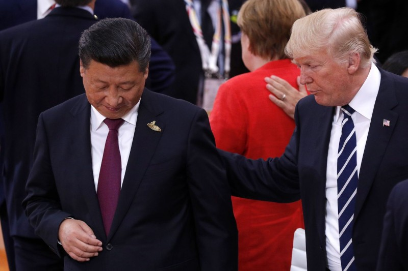 U.S. President Donald Trump talks with Chinese President Xi Jinping at the G20 meeting in Hamburg, Germany, on July 7. (Philippe Wojazer/AFP/Getty Images)