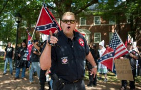 A member of the Ku Klux Klan shouts at counterprotesters during a rally calling for the protection of Confederate monuments, in Charlottesville, Virginia, on July 8.