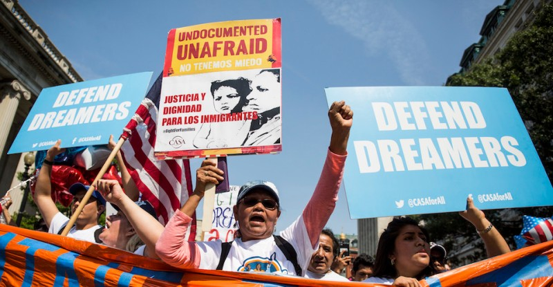WASHINGTON, DC - SEPTEMBER 5:  Demonstrators march during a demonstration in response to the Trump Administration's announcement that it would end the Deferred Action for Childhood Arrivals (DACA) program on September 5, 2017 in Washington, DC.  DACA, an immigration policy passed by former President Barack Obama, allows certain undocumented immigrants who arrived in the United States as minors to receive renewable two-year deferred action from deportation and eligibility fork a work permit. (Photo by Zach Gibson/Getty Images)
