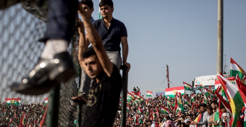 Supporters wave flags and chant slogans inside the Erbil Stadium while waiting to hear Kurdish President Masoud Barzani speak at a rally for the upcoming referendum for independence on Sept. 22.