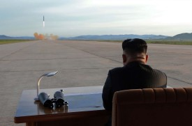 North Korean leader Kim Jong Un looks on during the launch of a Hwasong-12 missile. (STR/AFP/Getty Images)
