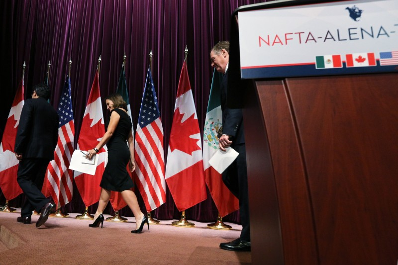 Canadas Minister of Foreign Affairs Chrystia Freeland(C), Mexicos Secretary of Economy Ildefonso Guajardo Villarreal(L) and United States Trade Representative Robert E. Lighthizer leave the stage at Global Affairs on the final day of the third round of the NAFTA renegotiations in Ottawa, Ontario, September 27, 2017. / AFP PHOTO / Lars Hagberg        (Photo credit should read LARS HAGBERG/AFP/Getty Images)