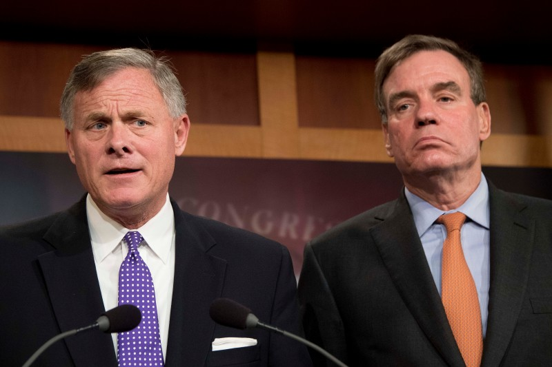 Senate Intelligence Chairman Richard Burr (L), R-N.C.; and Senate Intelligence Vice Chair Mark Warner, D-Va., hold a news conference on the status of the committee's inquiry into Russian interference in the 2016 election on Capitol Hill in Washington, DC, October 4, 2017. (JIM WATSON/AFP/Getty Images)