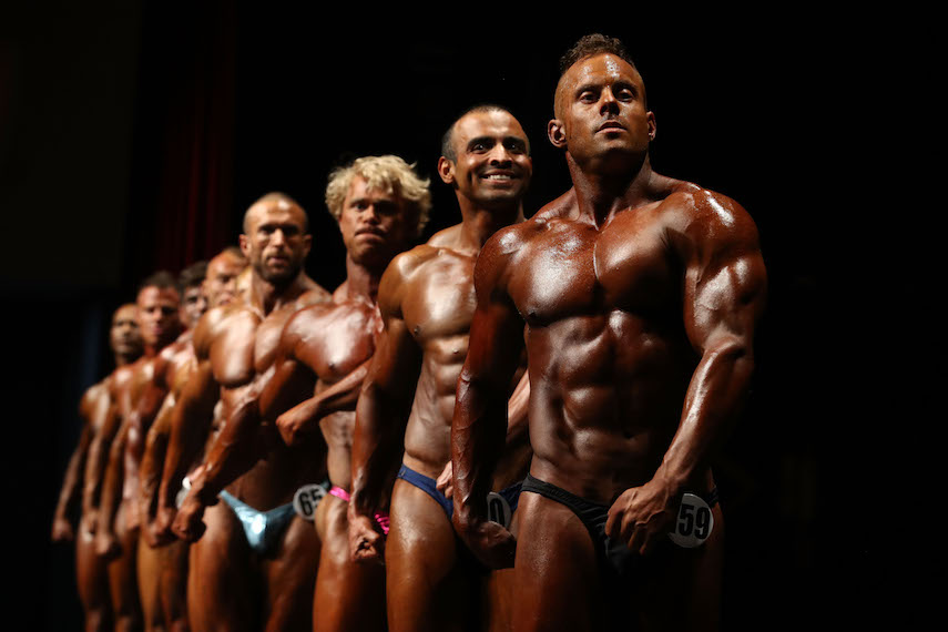 MELBOURNE, AUSTRALIA - OCTOBER 08:  Competitors pose on stage during the Victorian Bodybuilding Championship on October 8, 2017 in Melbourne, Australia.  (Photo by Robert Cianflone/Getty Images)