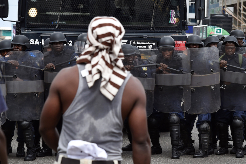 TOPSHOT - Liberian anti-riot policemen take part in an exercise in Monrovia on October 9, 2017, on the eve of the country's presidential elections. Liberians go to the polls on October 10, 2017, to pick their first new president in 12 years as Ellen Johnson Sirleaf closes the page on two terms dominated by post-war reconstruction and the Ebola crisis. / AFP PHOTO / ISSOUF SANOGO        (Photo credit should read ISSOUF SANOGO/AFP/Getty Images)