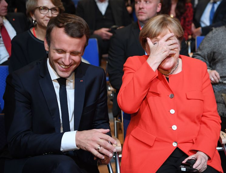 French President Emmanuel Macron and German Chancellor Angela Merkel laugh prior to the opening of the Frankfurt Book Fair on October 10, 2017 in Frankfurt am Main, western Germany. Macron takes his push for deeper European integration to Germany, where he and German Chancellor will launch the world's largest book fair in Frankfurt. France is this year's guest of honour at the October 11-15 Frankfurt Book Fair, where more than 7,000 exhibitors from more than 100 countries are expected. / AFP PHOTO / dpa / Arne Dedert / Germany OUT        (Photo credit should read ARNE DEDERT/AFP/Getty Images)